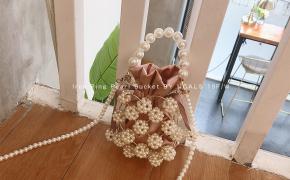 淘宝集运转运到意大利UGALS复古名媛手工编织镂空串珠手挽水桶包珍珠包包手提斜挎包女